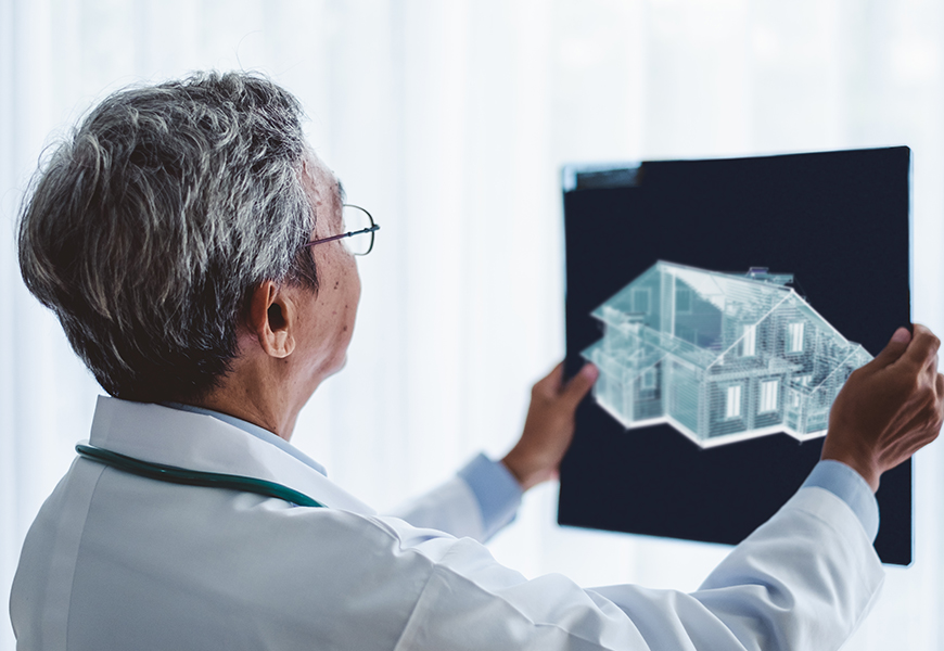 Dr. looking at an xray of a house