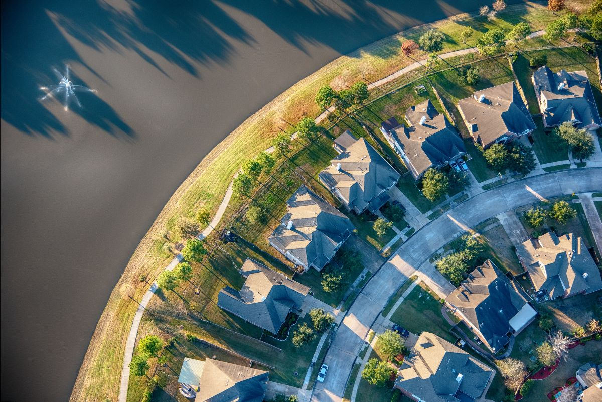 Aerial view of a residential subdivision in the suburbs of Houston, Texas consisting of water front homes and manicured landscaping.