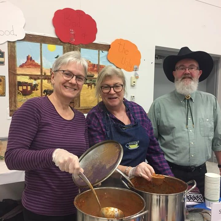 Group of volunteers serving chili
