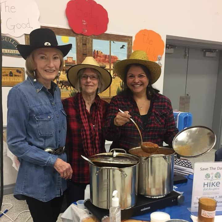 Volunteers serving chili