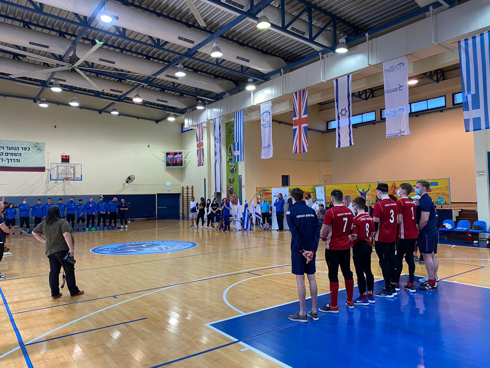 The GB team standing together on court before the match opposite the Israel men's team.