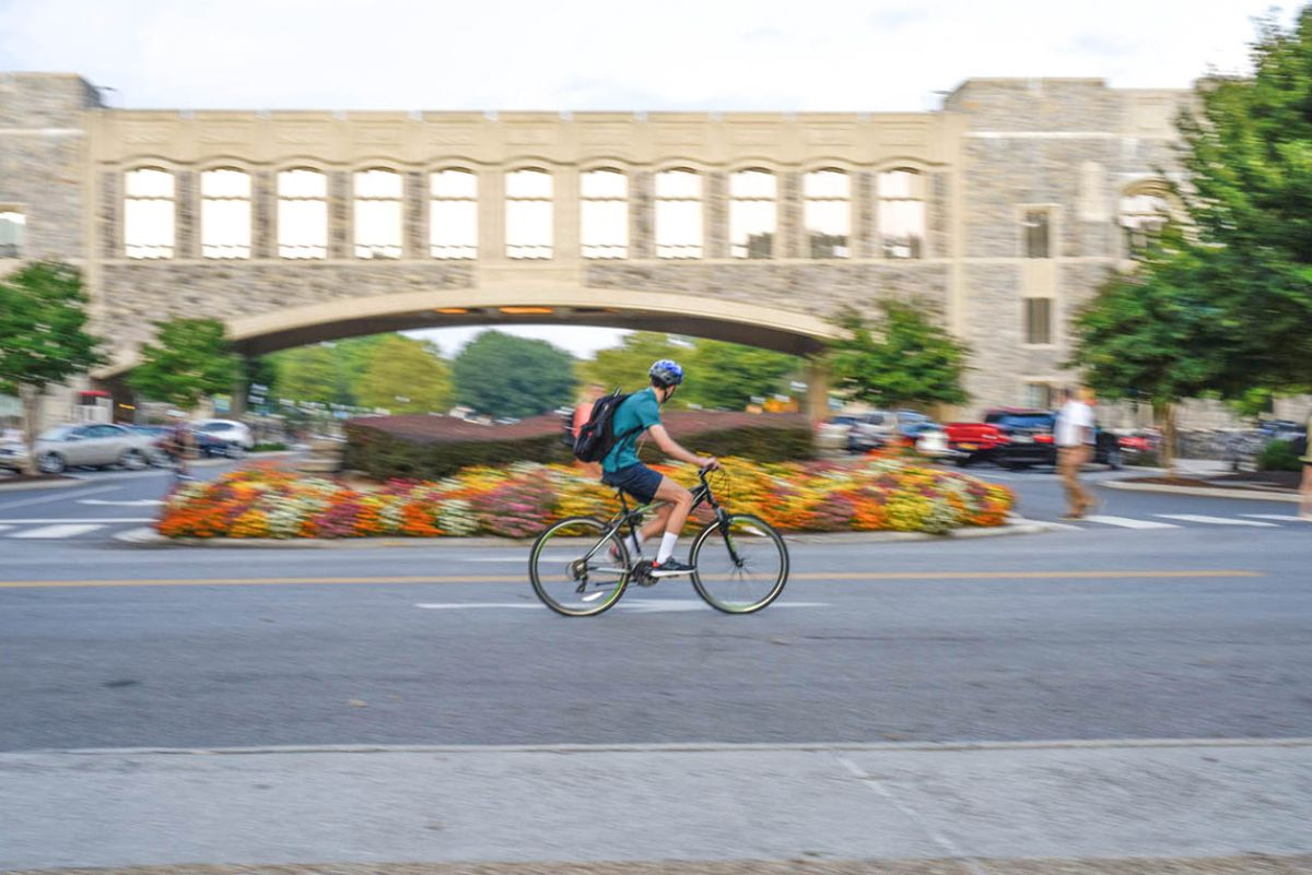 Cyclist riding in front of Torgersen