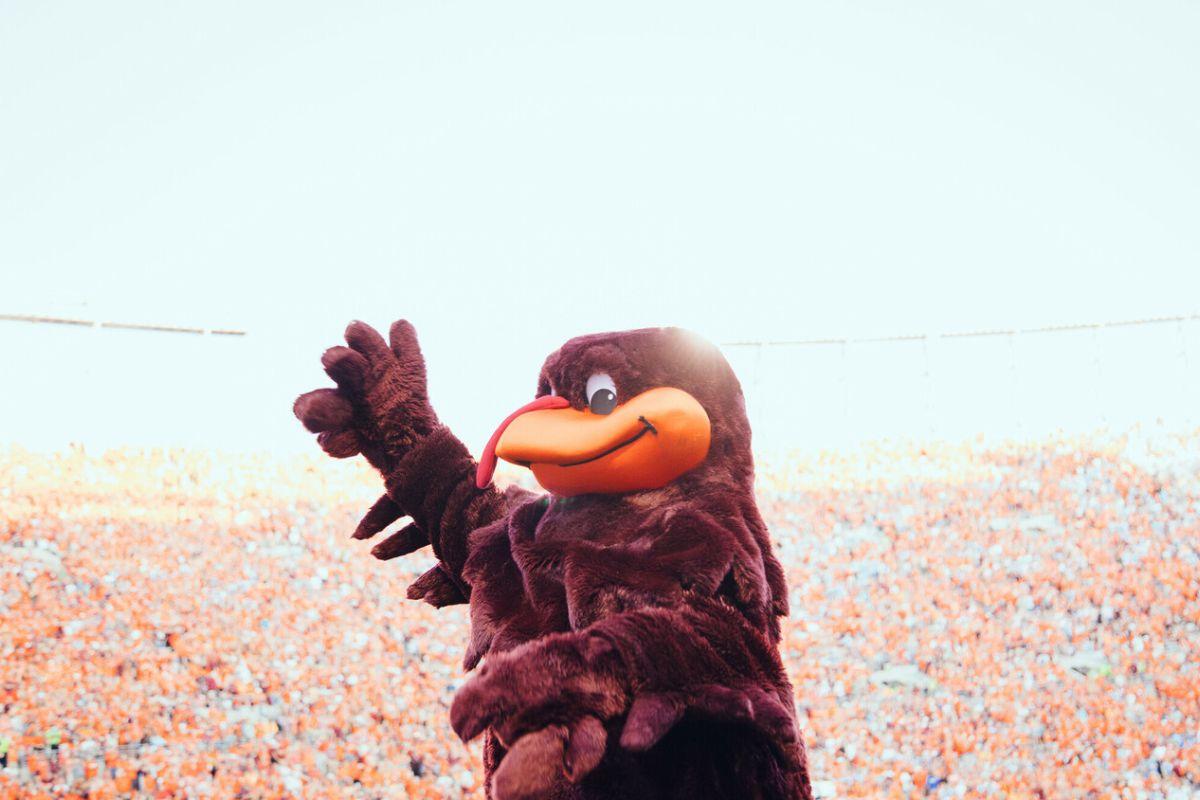 HokieBird waving to a full crowd in Lane Stadium