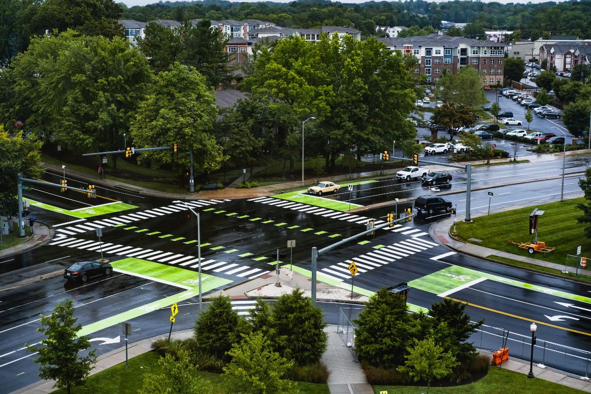 Stanger street and Prices Fork Road intersection with wet pavement and new green bike boxes painted at each stop light
