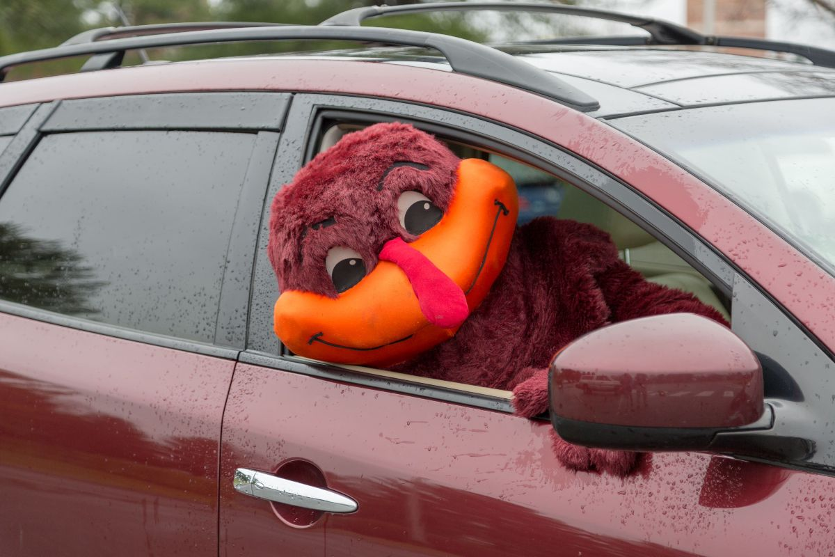 HokieBird smiling while sitting in the passenger seat of a car