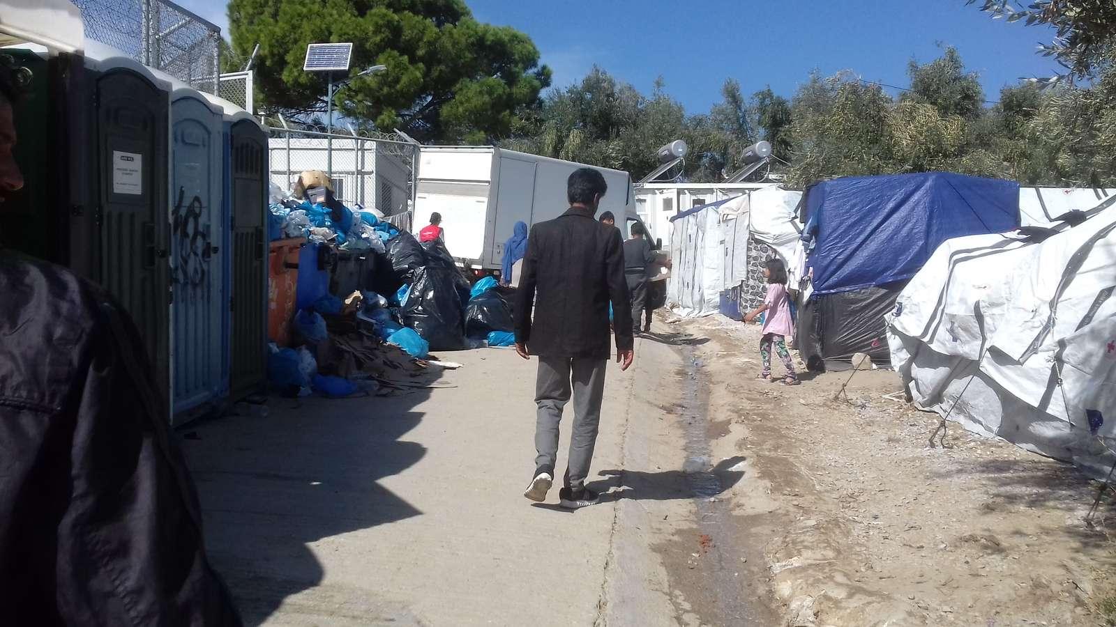 Man walking in Moira Camp