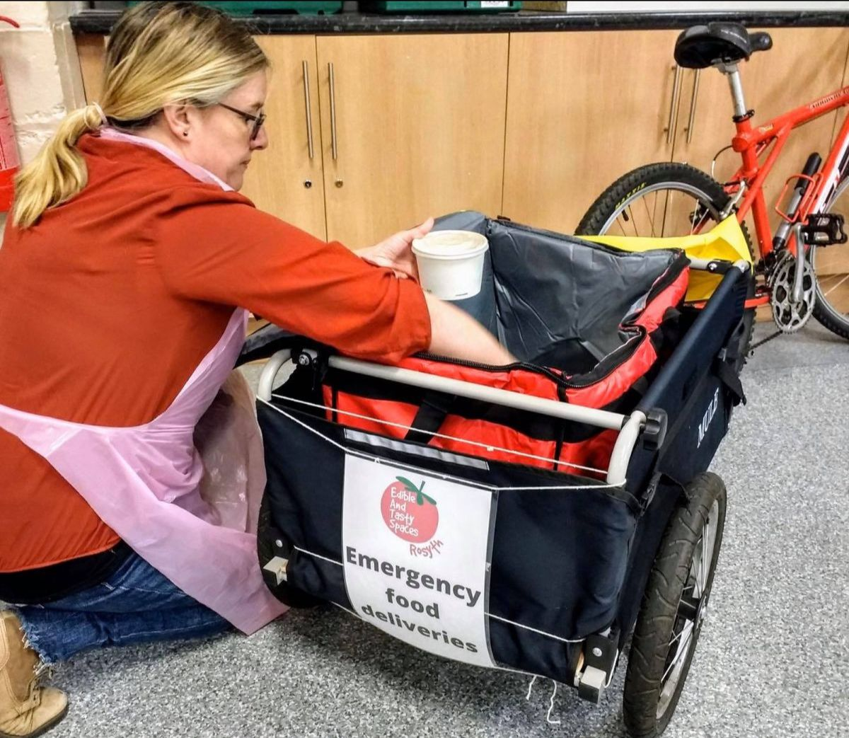 EATS Rosyth Food Project Manager Karen, filling the trolley on back of delivery bicycle.