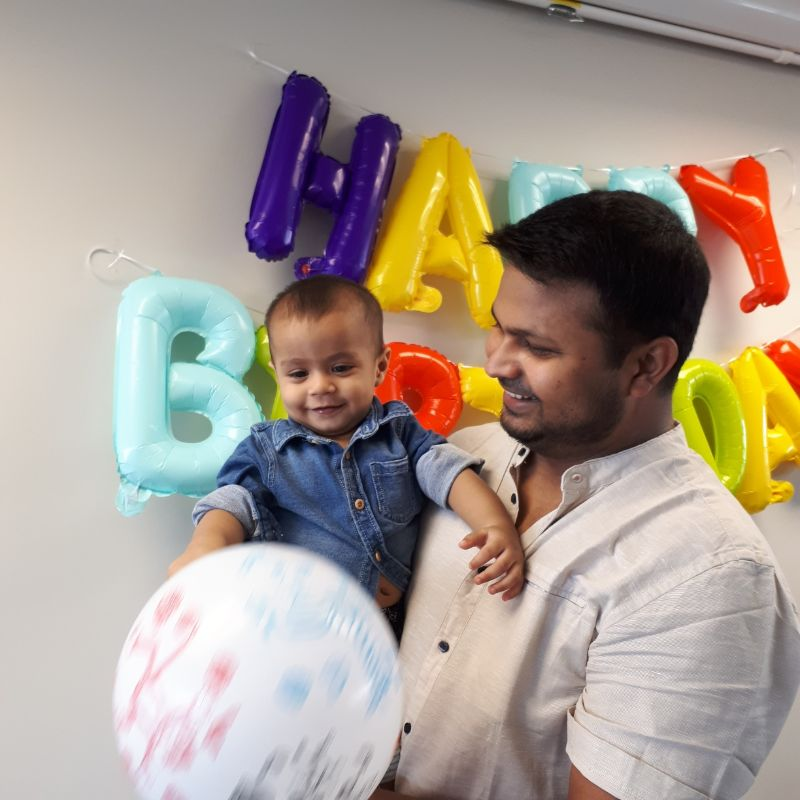 Zayan celebrating his 1st birthday with his father.