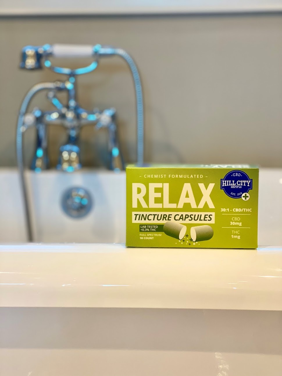 Box of Relax Tincture Capsules sitting on the edge of a sink