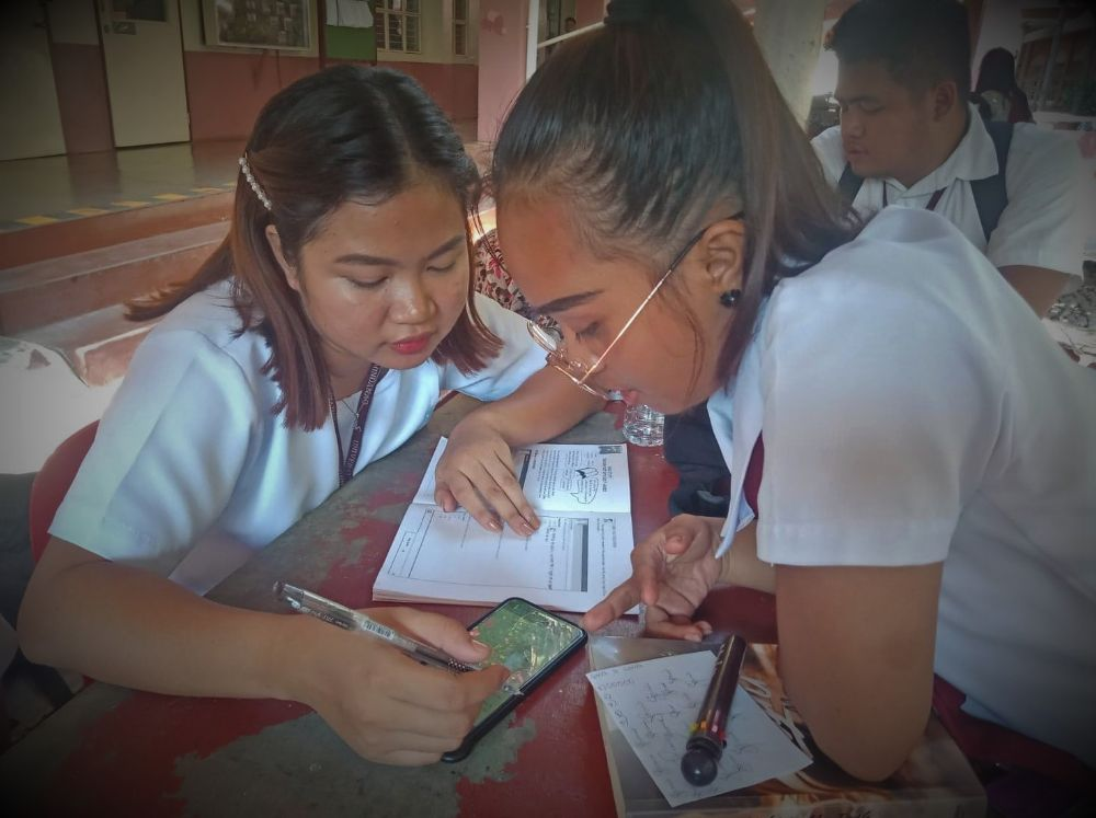 Growing in the Word.  Sarah (right) with her classmate during a small group activity.