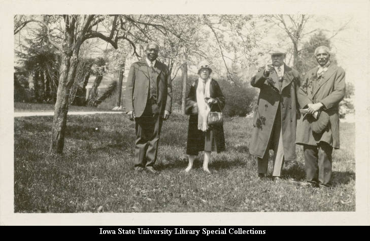 Photo of George Washington Carver, Louis Pammel, and two others on Tuskegee University's campus