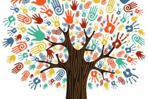 A tree with multi colored handprints representing diversity.