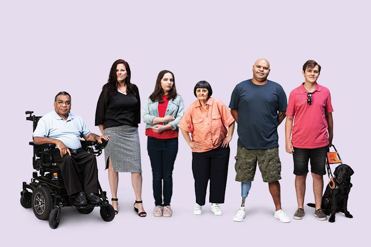Group image of six people, one is in a wheelchair, one has a guide dog, one has a prosthetic leg, and three do not have visible disabilities.