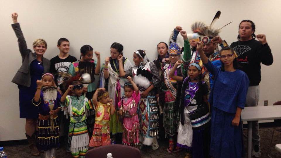 PHoto of youth powwow dancers