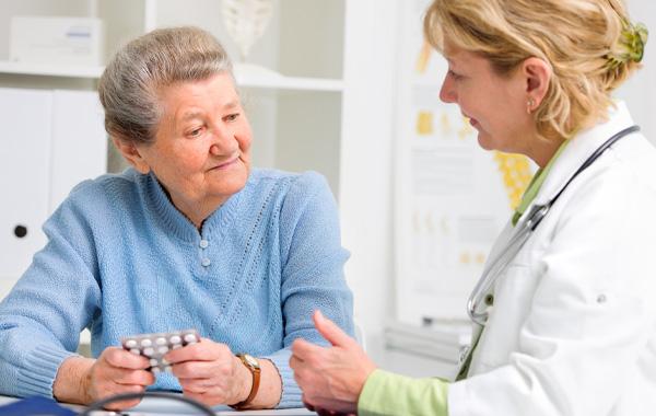Elderly female talking to her provider