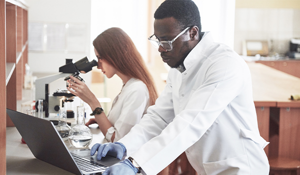 Microbiologists busy in the lab.