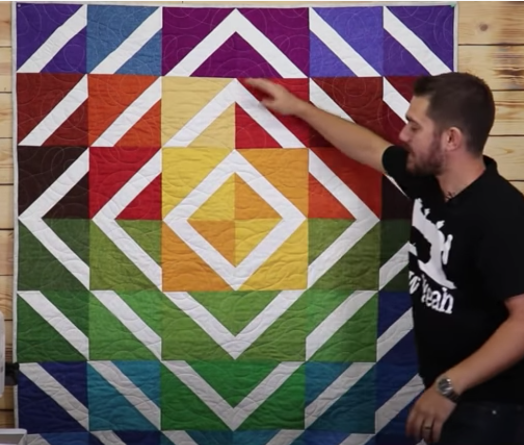 Tunnel of light quilt - bright colours with diamonds of white radiating out