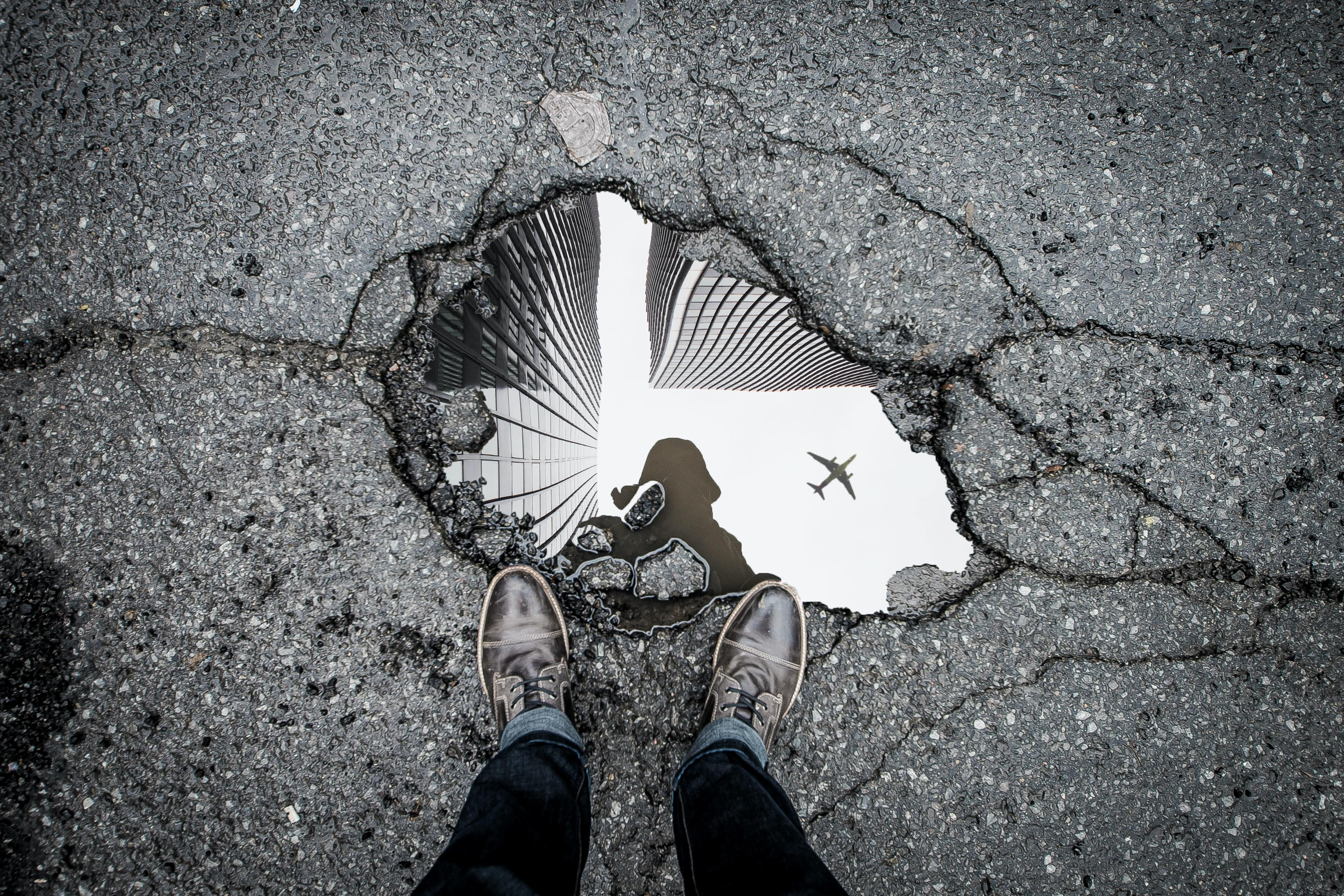 Person Staring into a Puddle