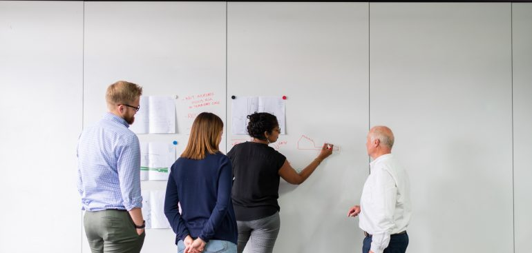 Team Writing on a White Board