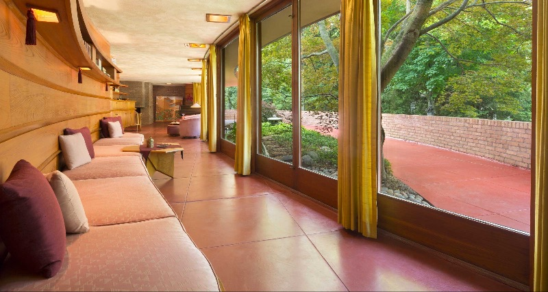 Corridor and floor to ceiling windows in home designed by a legendary architect.