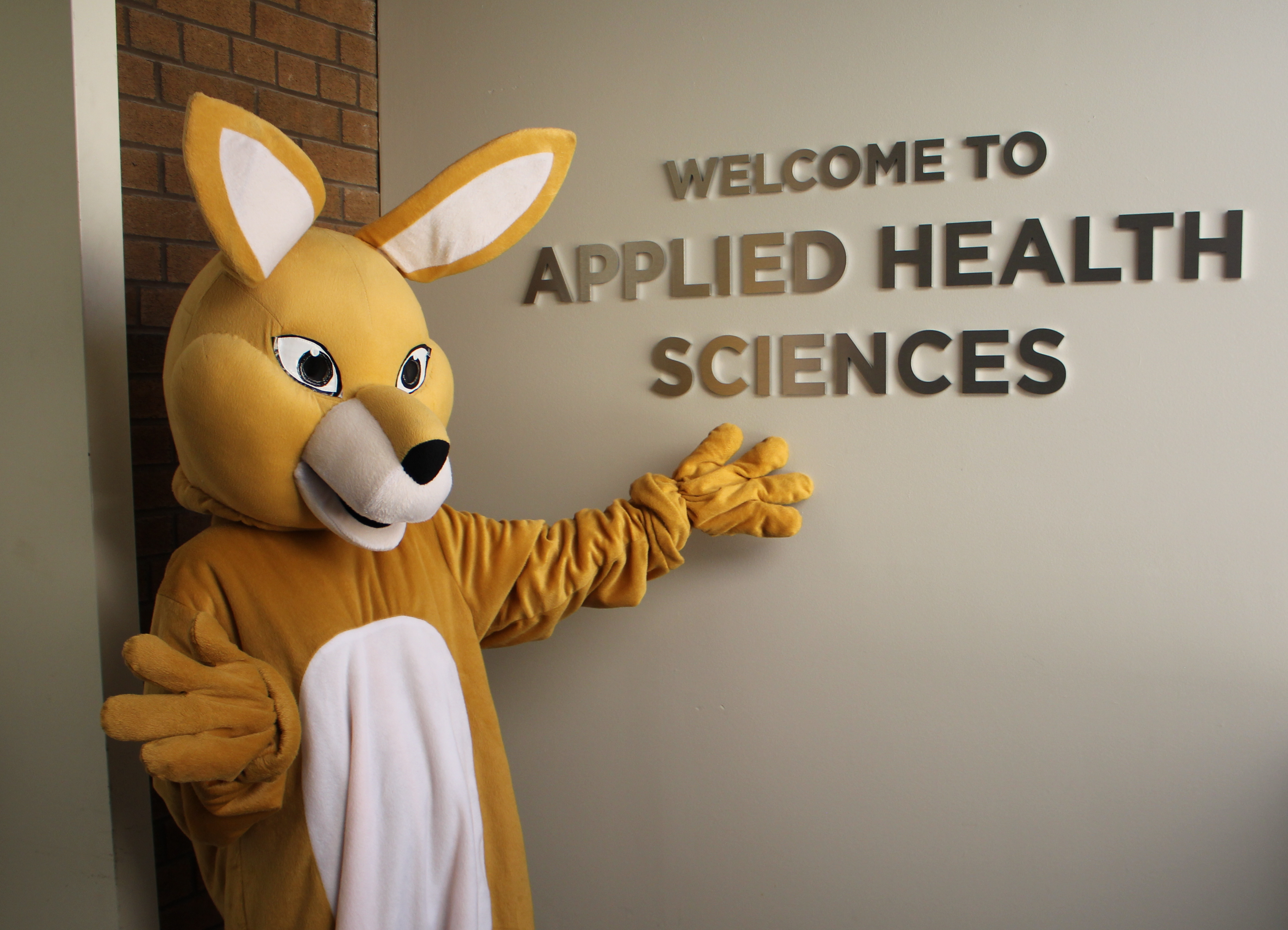 AHSSIE in front of Welcome to Applied Health Sciences sign