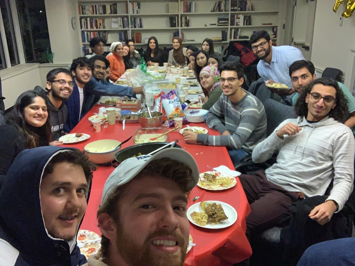 This is a photo of our most recent Friendsgiving event. We're all around the table ready to eat!
