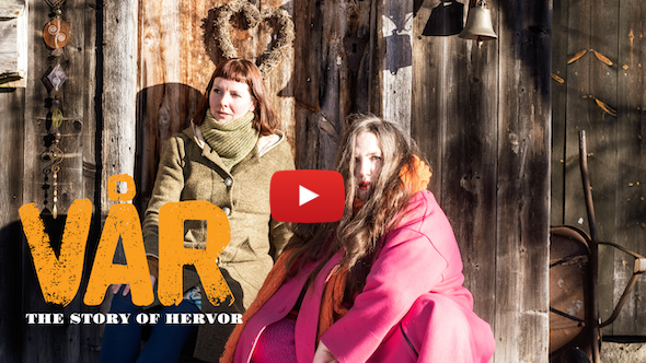 artists Heidi Dahlsveen & Kristin Bolstad outside a log cabin with the title of the show and a red youtube play button