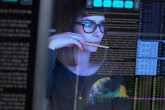 Woman in front of computer screen