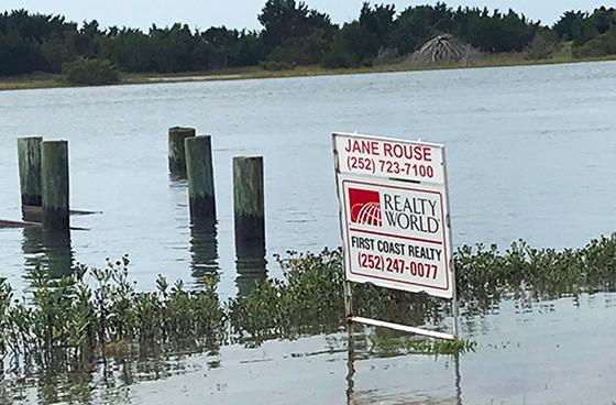 Flooded real estate sign