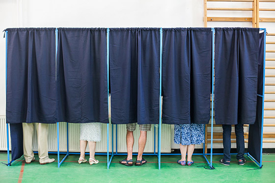 People at voting machines