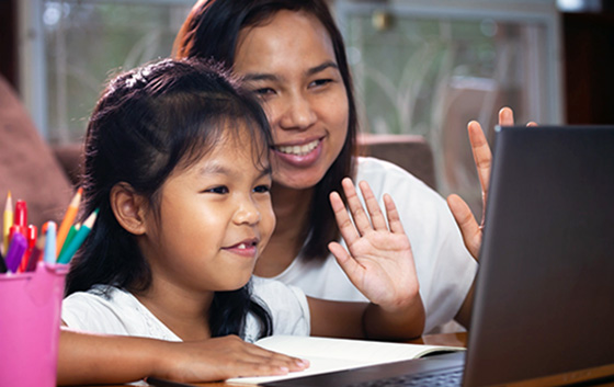 Mom and daughter doing remote learning