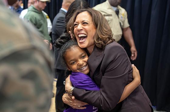 Kamala Harris hugging a child from Biden campaign website