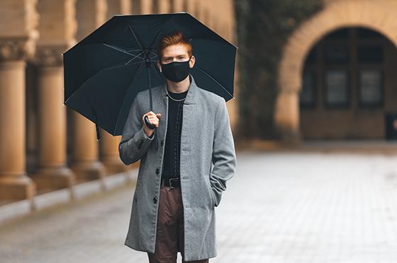 Undergraduate holding an umbrella