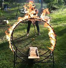 A croquet obstacle that is a hoop on fire