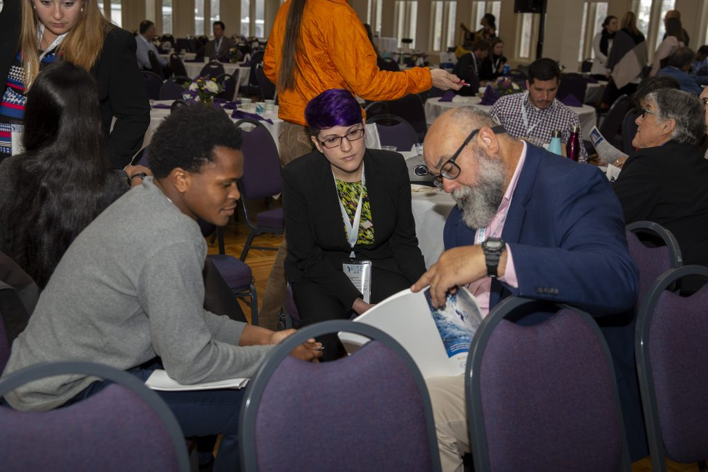 From left: CRC students Alex Halloway of UNC-Chapel Hill and Sarah Lipuma of Duke University discuss presentations with Cecilio Ortiz García, Senior RISE Fellow with the National Council for Science and the Environment. Photo By Brian Busher, University of Albany.