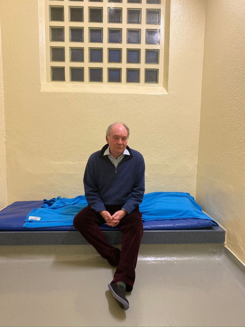 Philip sitting in the cell