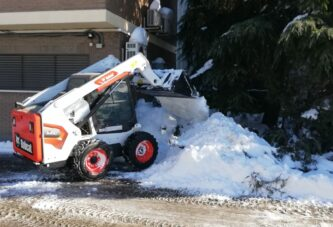 Bobcat get stuck into digging Madrid out of the snow