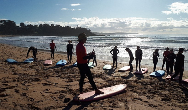 Hawker College students participate in a surfing lesson