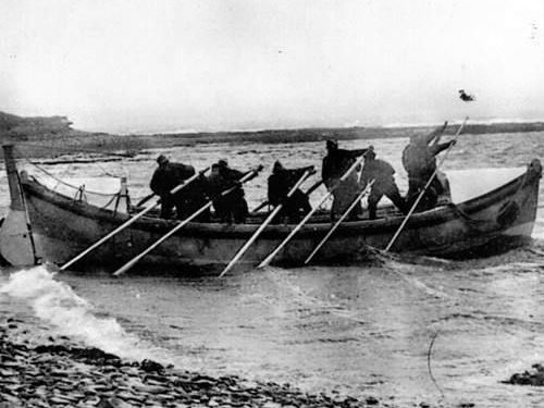 Volunteer lifeboatmen launch the 'Saltaire' lifeboat at Stromness, Orkney, c1880. Image credit: Stromness RNLI archive