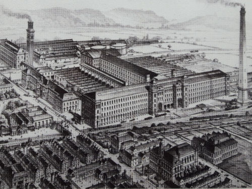 Aerial view of Salts Mill showing gas holders