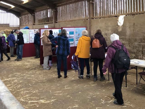 Visitors viewing display boards at Milner Field Farm