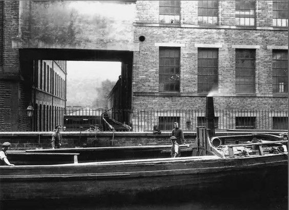 Barge on the canal with a coal conveyor
