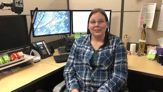 Pix of Alison sitting at her workstation.