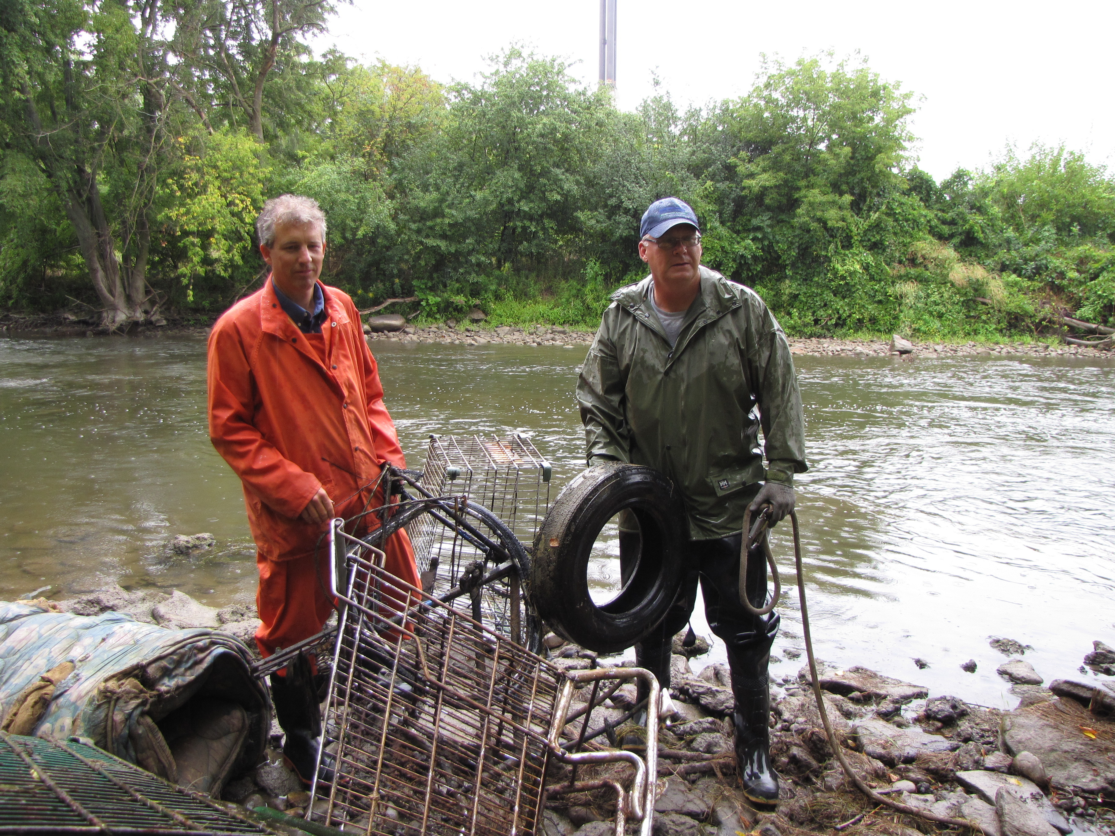 Volunteers with the River Rally clean up garbage from the Thames in downtown London Photo: UTRCA