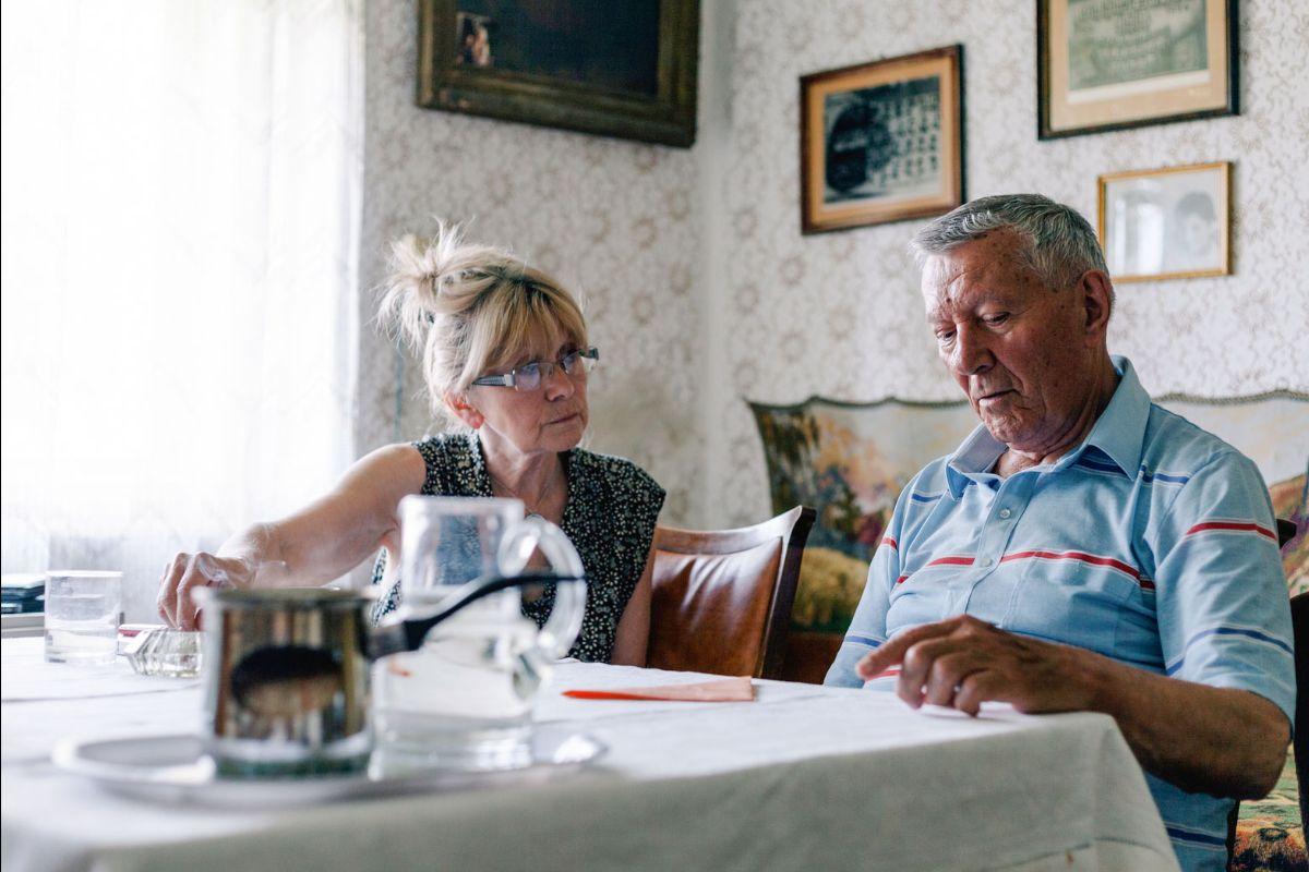 older couple having a serious conversation advanced directives