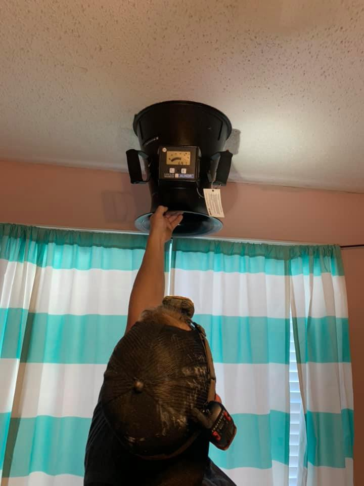 technician checking air ducts
