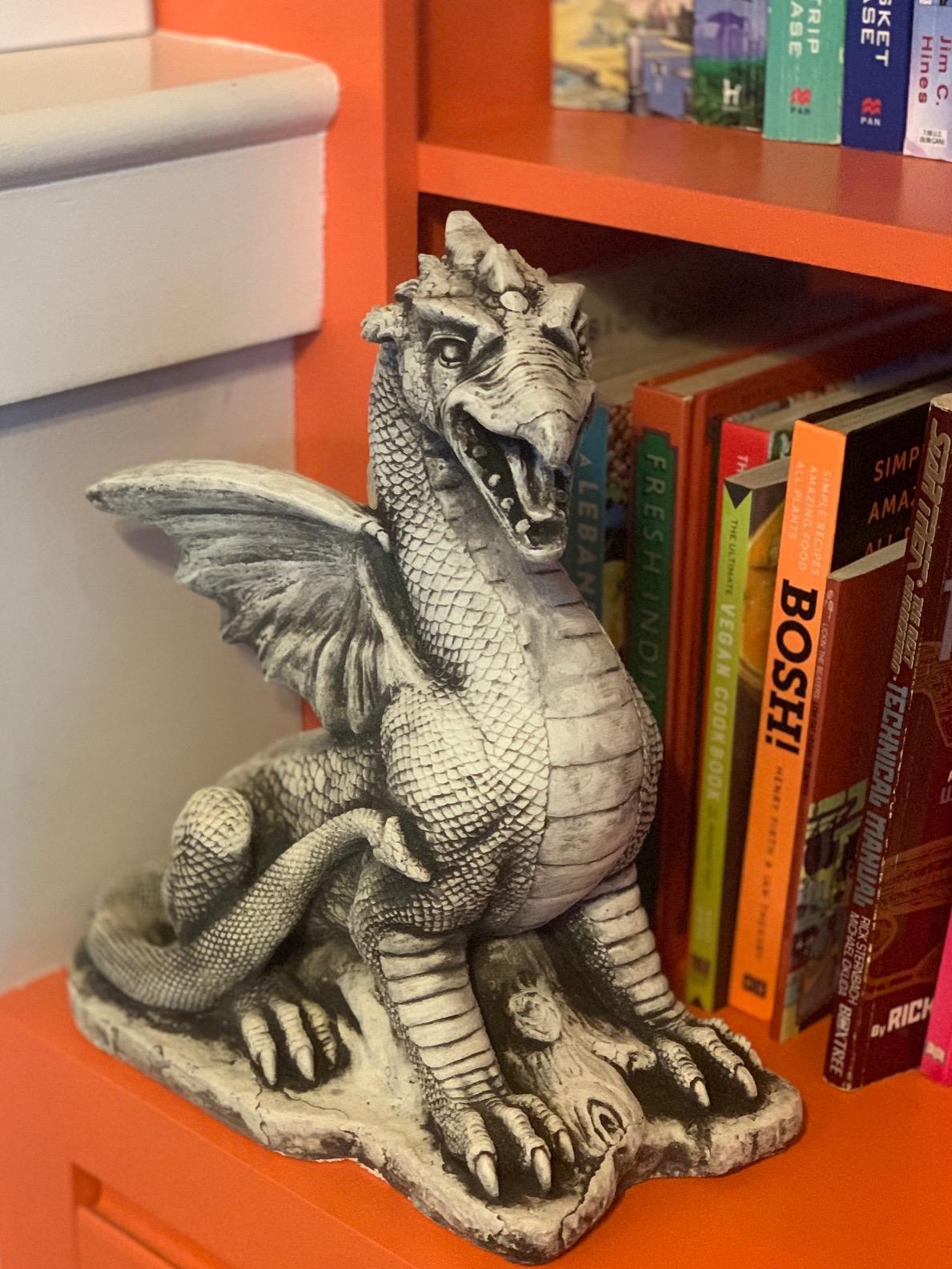 Stone dragon on a bookshelf