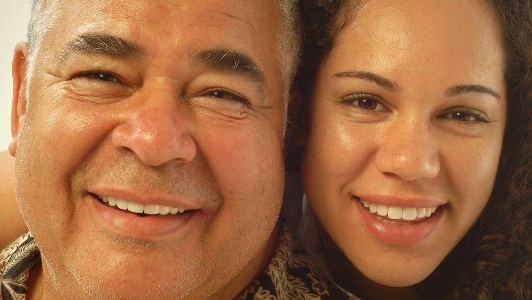 man and daughter smiling