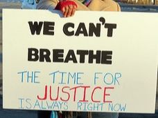 "Sign that says ""We can't breathe the time for justice is always right now."""