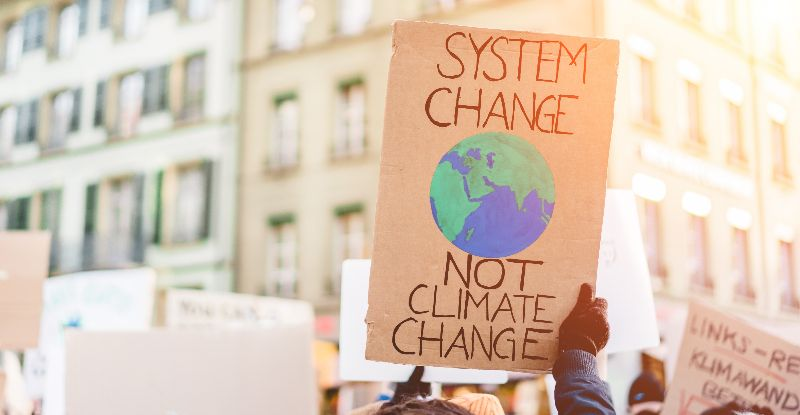 person holding up a climate change poster